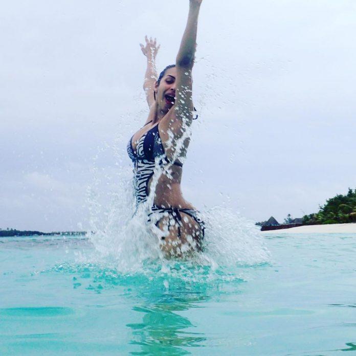 """malaika-arora-gets-trolled-for-bikini-pics-posted-on-insta"